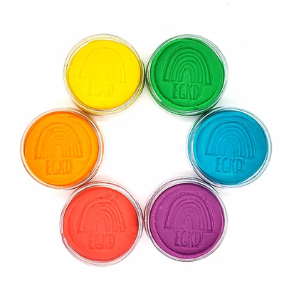 Six round containers of colorful playdough in colors green, blue, purple, red, orange, and yellow.