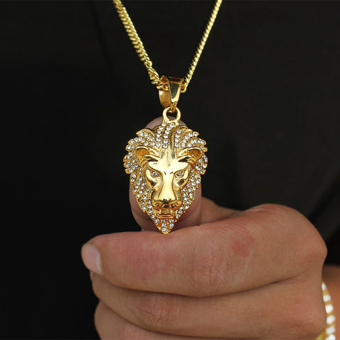 man holding iced out lion chain