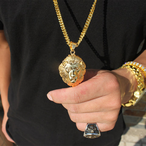 man holding lion necklace