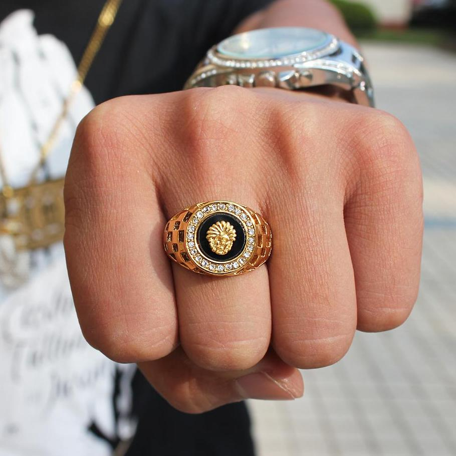 man wearing iced out lion ring gold