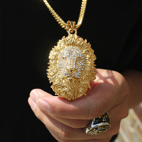 man holding a lion head pendant