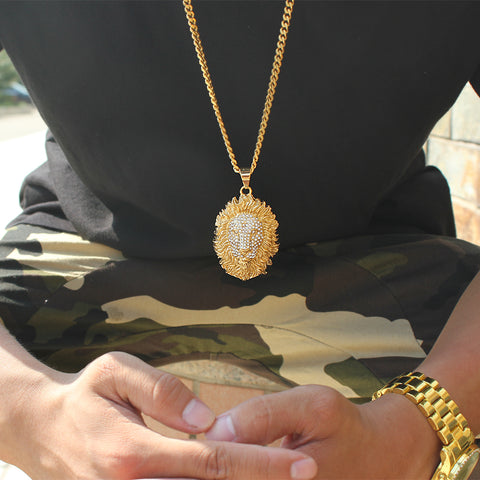 man wearing iced out lion head necklace