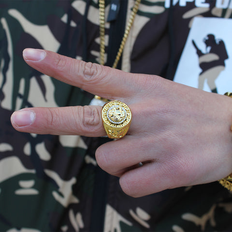 gold lion ring on finger