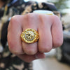 Image of man wearing lion gold ring