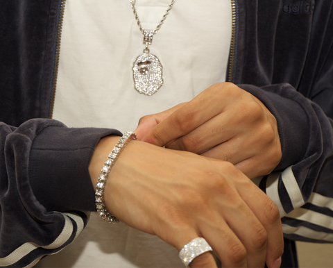 man wearing bape chain