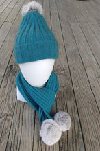 Cottontail possum merino beanie from Cosy Kiwi in Teal