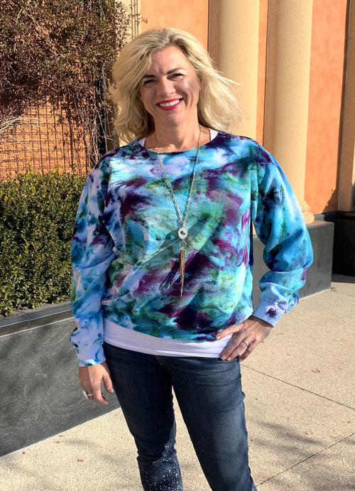 tie dye sweatshirt in shades of blues and purples
