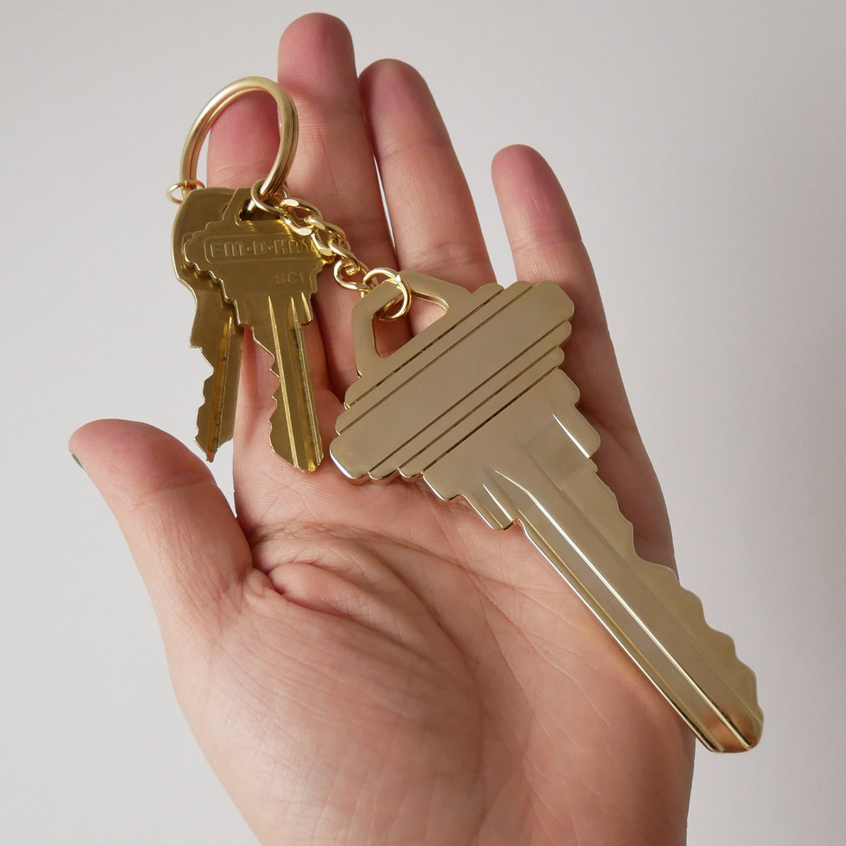 Studio Cult Key Key Chain Chain oversized key in hand