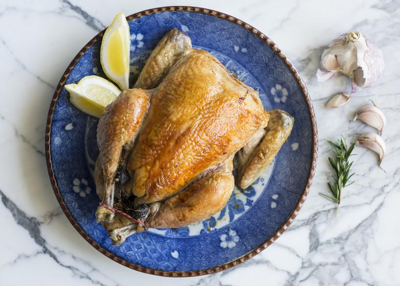 Inside out, herb butter-stuffed whole organic chicken