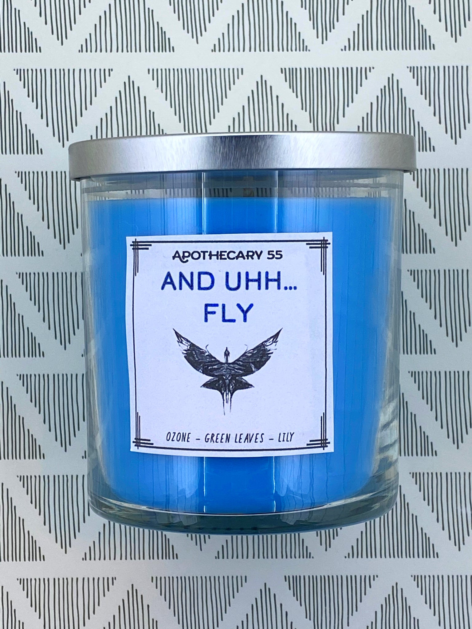 And Uh...Fly 9 oz. single wick candle