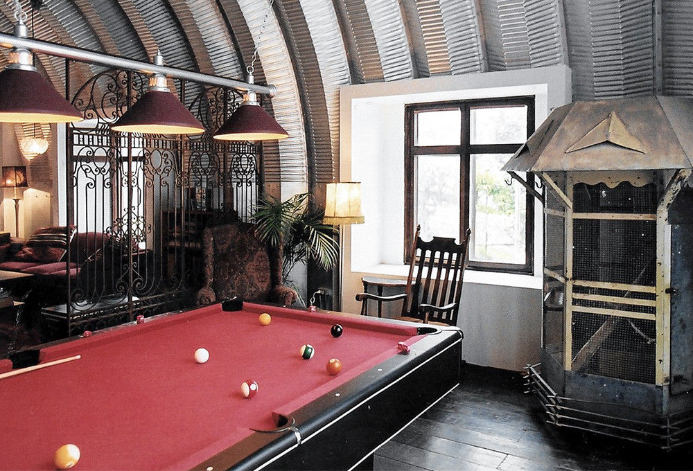 "The pool table at the back, with the ornate birdcage contain the parrot ""Long Gone Simm"" named after an actor who left before production started"