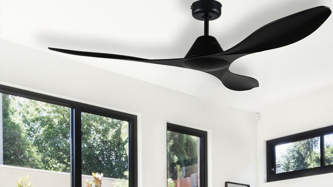 The top 5 Nevis ceiling fan in black installed in a house