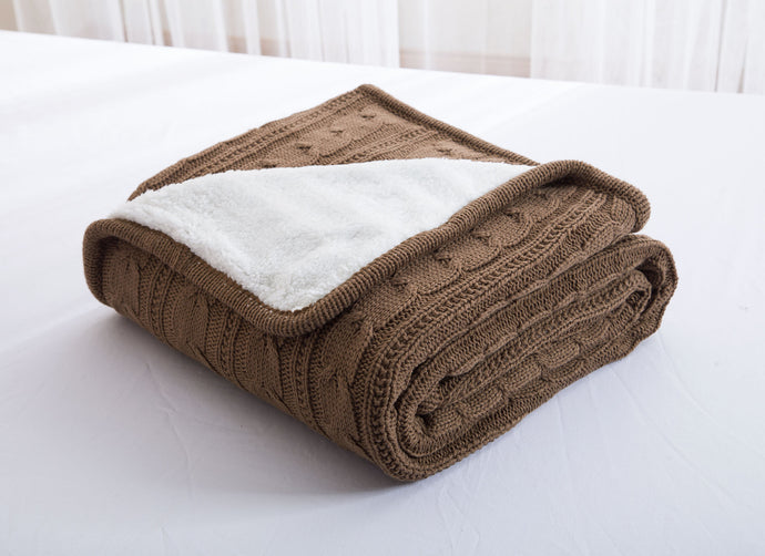 Folded chocolate brown bedspread throw by Lila Hampton