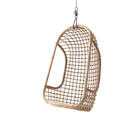 Whimsical hanging chair in natural rattan