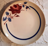 Plate rose flower and blue leaves
