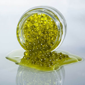 Olive Oil Pearls are the most refined way to use olive oil. Beautifully encapsulated olive oil into a natural algae capsule. Delicious and so easy to use on dishes !