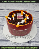 A cake in the form of an ashtray with favourite cigarette brand and buds lying around