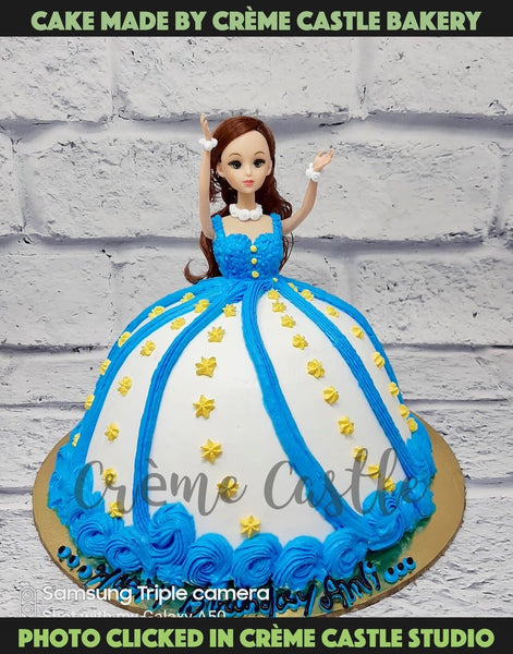 A cake in the form of a barbie with two coloured frock. The colour can be changed as per your requirement. It's a classic but always a hit