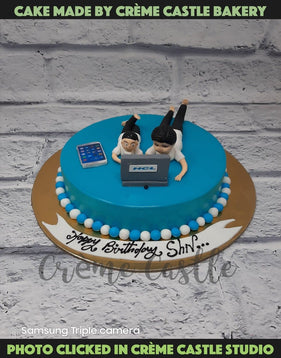 A cake for father and son where father is working and the son loves to watch his father work