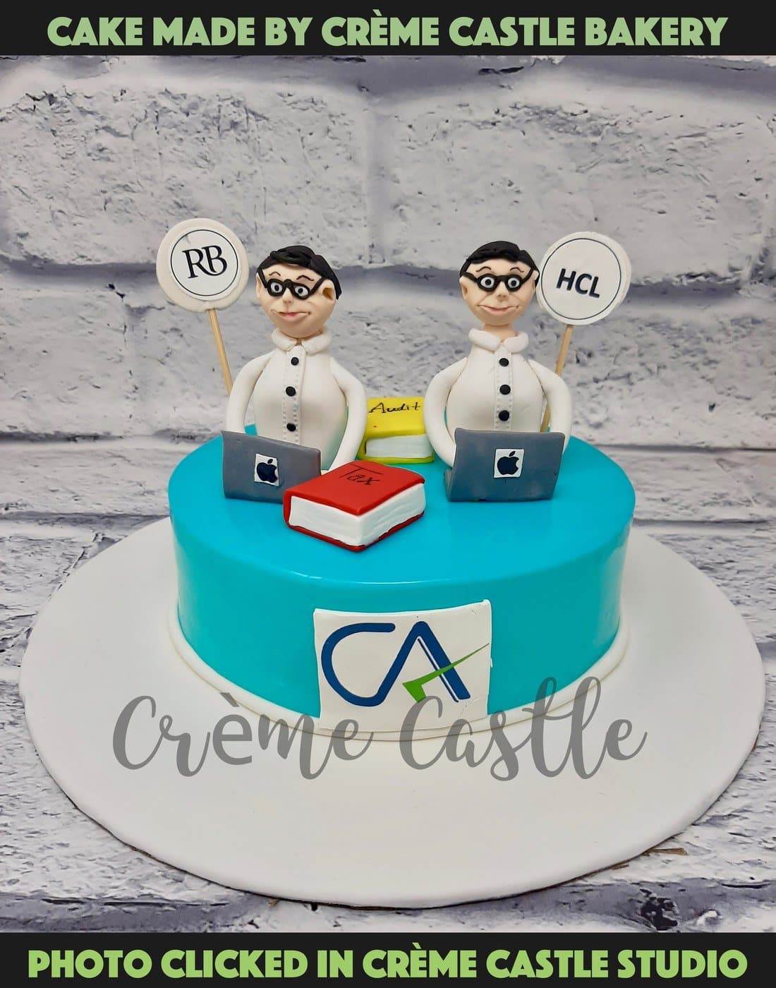 A cake for twin brothers who both are CA and love their work. A cake depicting both working on laptop with their companies name behind and CA logo at front