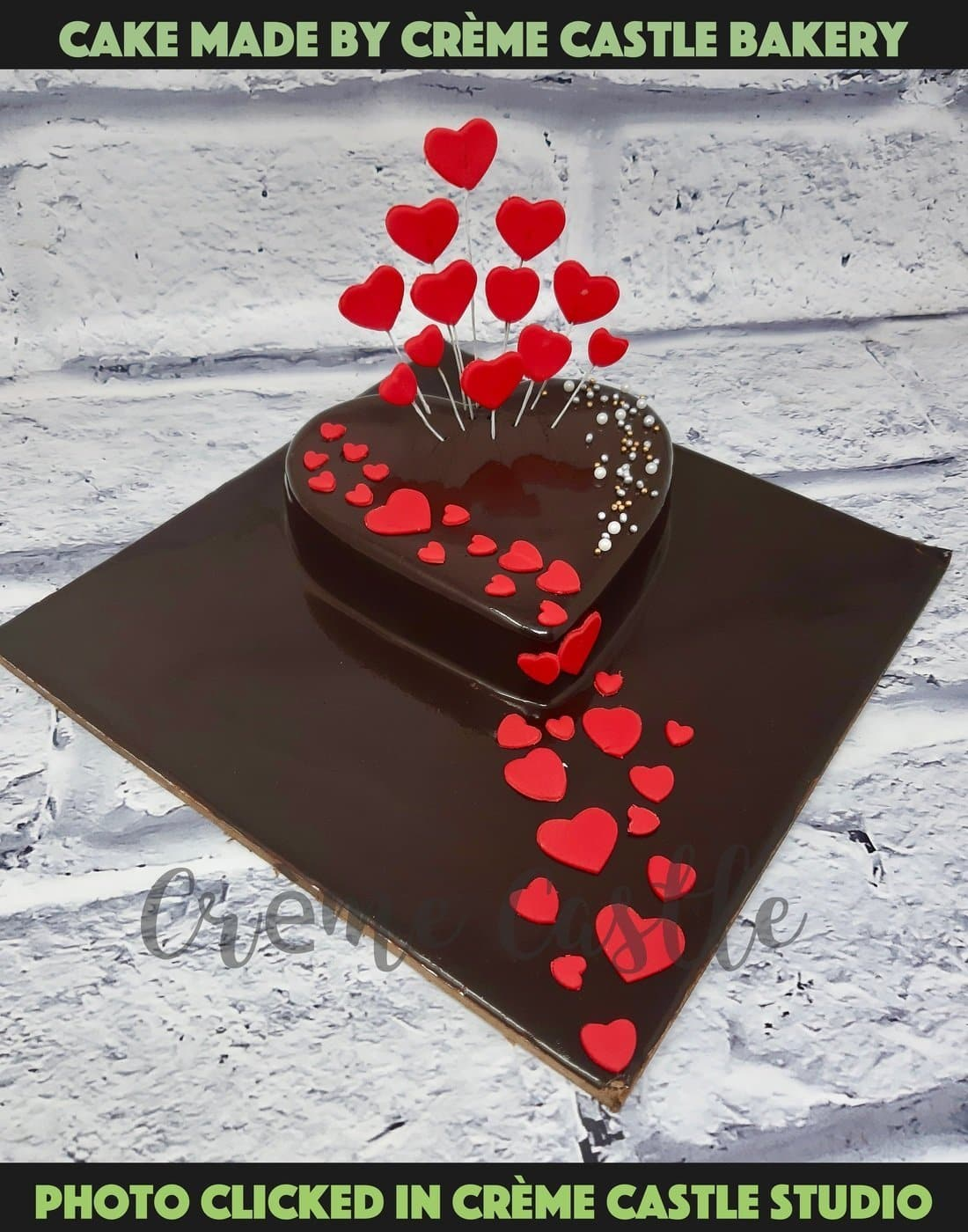 A chocolate based heart shaped cake with red hearts sprinkled all over the cake. Cake for someone who loves chocolate and loves you too
