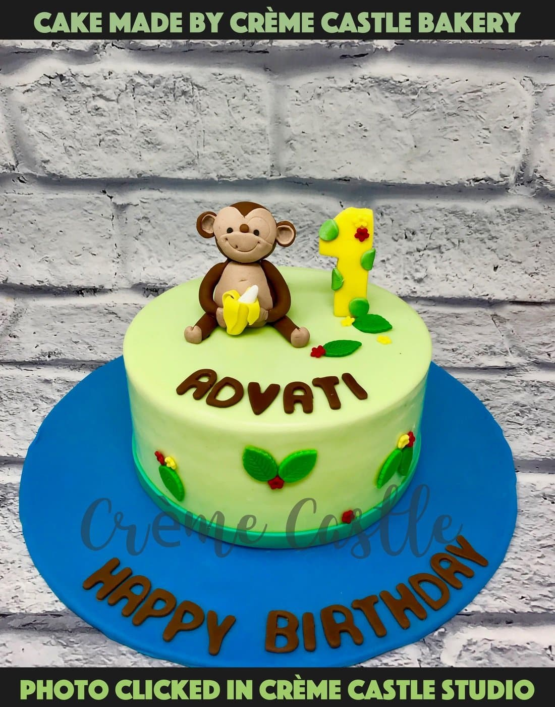 A cake with a baby monkey on top for a kid's first birthday with number 1 in banana theme. A cute cream covered cake
