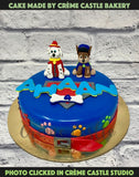 A paw patrol theme cake with their main characters on top in same colour theme and logo.