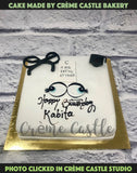 A cake for someone who has beautiful eyes. White theme cake with little bit of black
