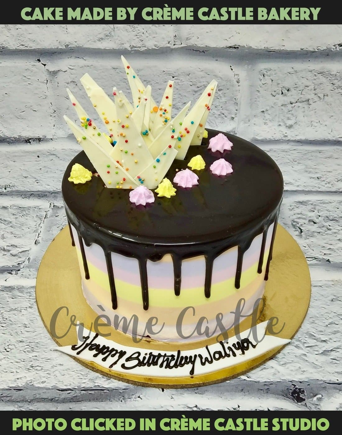 A colour theme cake with chocolate drip on top with design on the edge. A cake for every occasion