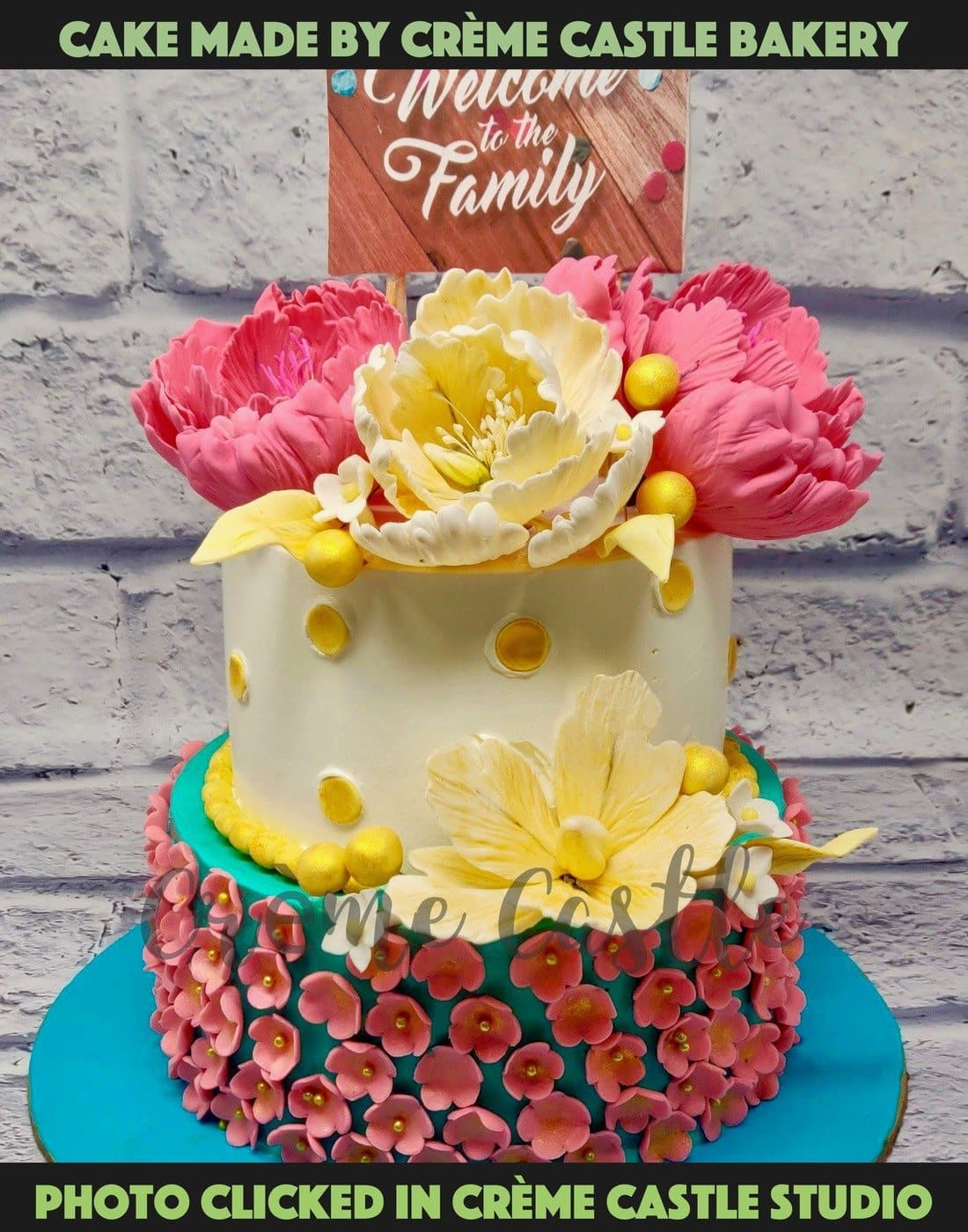 A cake made from rich butter cream with hand crafted flowers all over cake. Theme of vintage pastel colours which give it a French 70s look