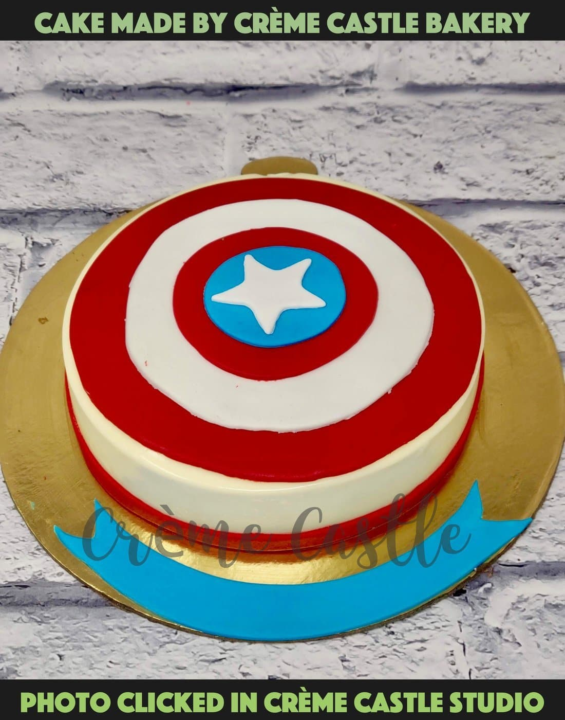 A cake for a true Captain America fan with his classic shield logo at the top in red, blue and white theme. Avengers assemble.