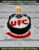 A cake for a die hard fan Ultimate Fighting Championship UFC. A wrestler at the top ready to kick some butt.