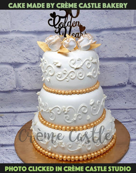 A 3 layer cake with elegant fondant design made for grand ceremonies. A full fondant made with artistic precision