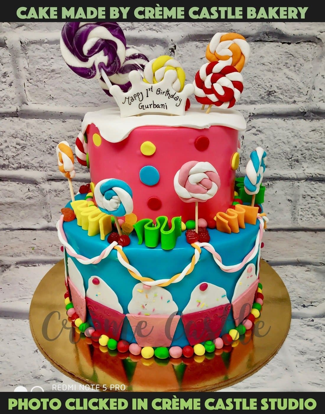 A Candyland tier cake with lollypop and candies all over the cake with colors dripping over cake