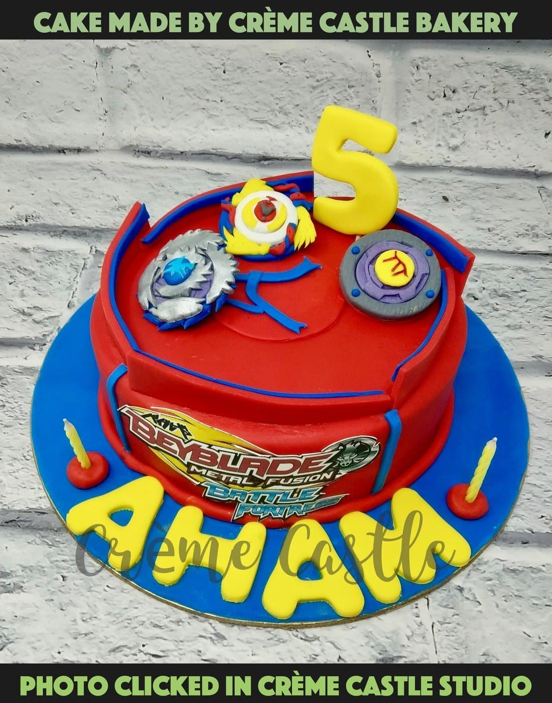 A beyblade theme cake with some amazing beyblades rolling over the top