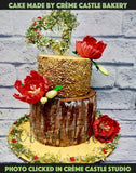 A wedding cake made with extra care with hand painted wooden strokes and hand crafted flowers