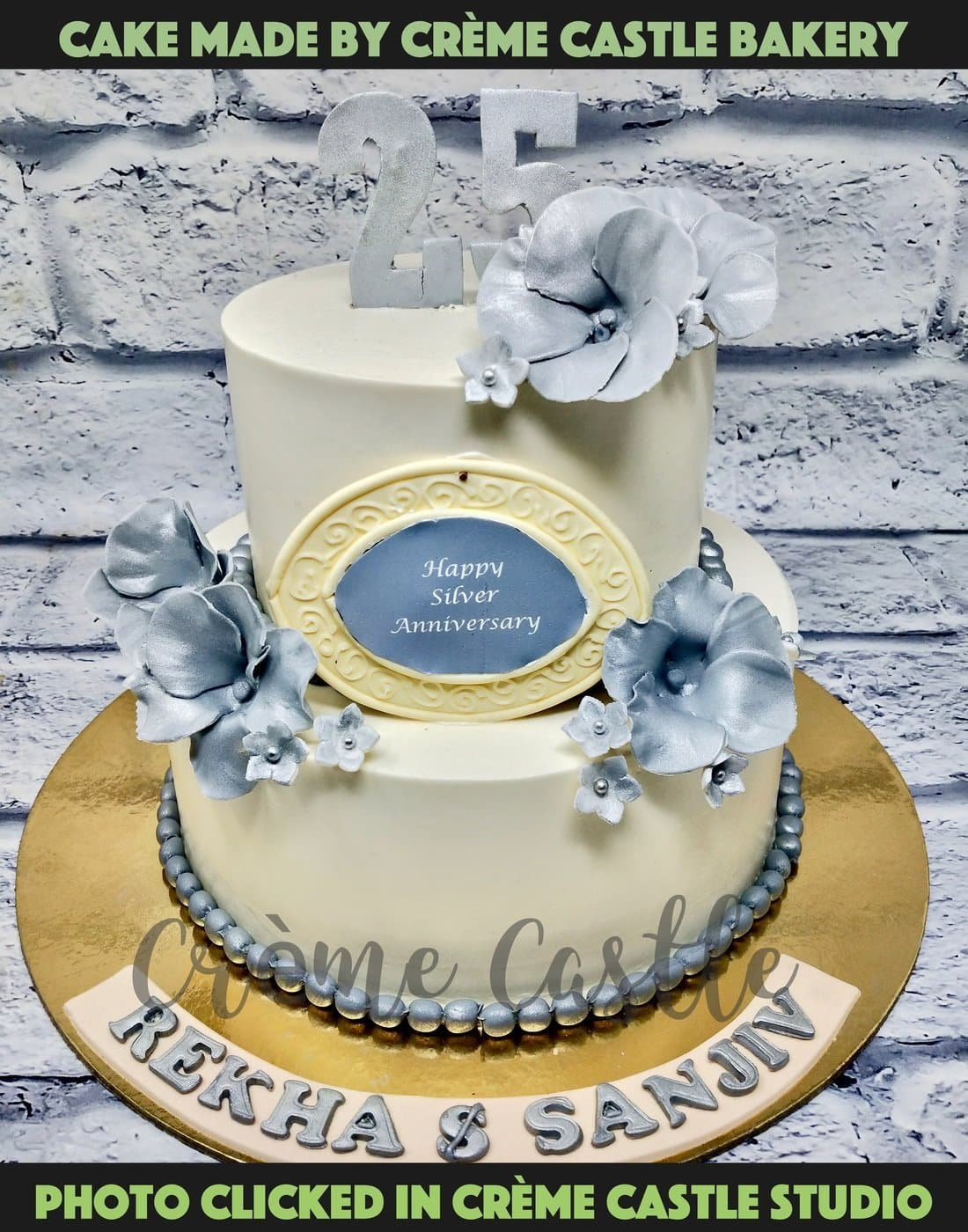 A cake for 25th Silver Anniversary in white and silver theme