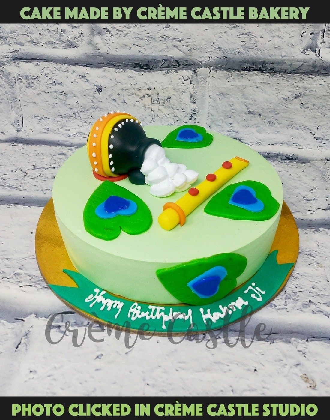 A Janmashtmi Theme cake with flute and matki on top