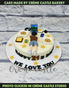 A cake for someone who like to be on laptop, lying with food around
