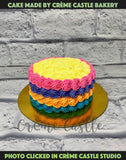 A rainbow theme cake with rainbow cream decorated on the outside