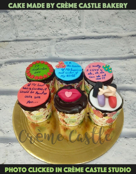 A 6 pcs Valentine theme cake with couple and messages on the cupcakes