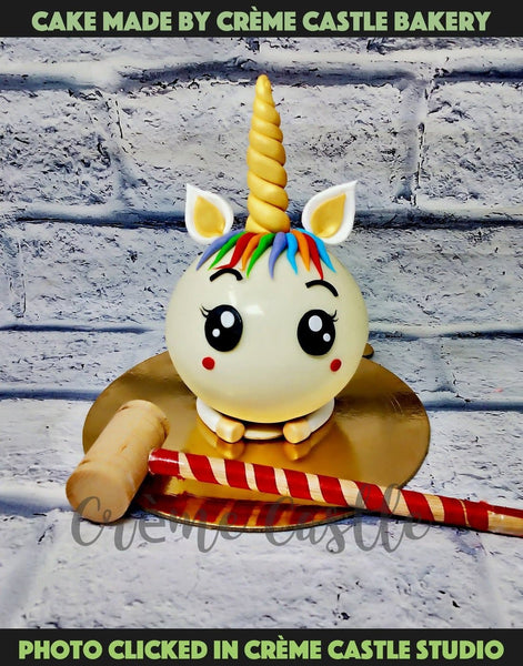 A round Pinata Shape cake with unicorn theme in round shape. Smash the cake and find another surprising cake inside. Hammer will be given with the cake. Delivery in Gurugram, Noida and Greater Noida