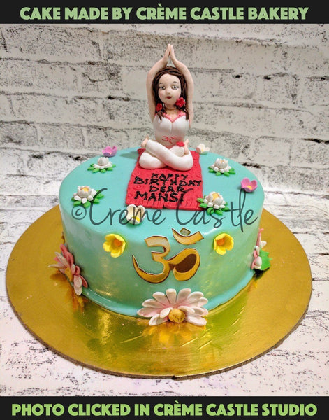 A yoga theme cake decorated with flowers all over and a woman on top doing yoga. Order cake online | Noida and Greater Noida. For any assistance or modification in cakes (in size or color or type) call at +91-9654111480. Available in 4 flavors: Chocolate Truffle, Black Forest, Pineapple and Butter Scotch