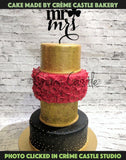 Red and golden wedding cake - cremecastle