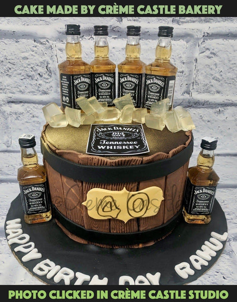Chocolate cake designed with little bottles of jack Daniels whiskey