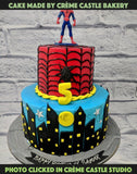 A Spiderman sitting on the top of skyscrapers to protect his city. The base layer is decorated with city lights on a blue starry night while top layer is themed in red colour embedded in the infamous Spidey web! Ideal for 5th birthday.
