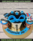 A cake for a father with a tuxedo theme and a blue bow and cupcakes with theme of love for father