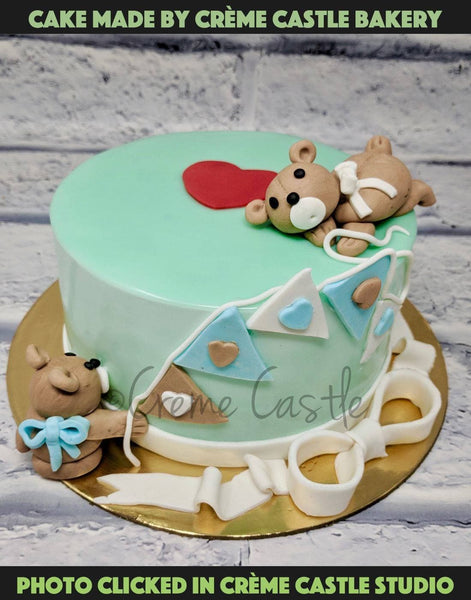 A cute cake with dog on top and around the cake for all the dog lovers out there