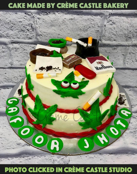 Marijuana theme cake for that spoilt one of your group who loves smoking. A white base decorated with marijuana leaves, rolled joint, Marlboro cigarettes- all the essentials!