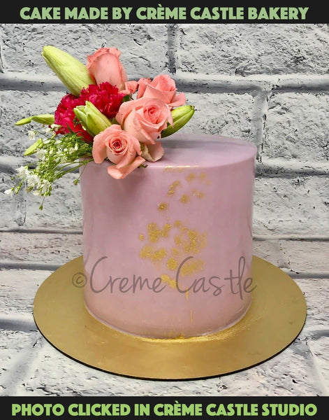 This Cake Is Delicately Decorated With Flowers And Is Perfect For People Who Love Nature And Are A Fans Of Flower Pots, And Gardening. Gift Them This Cake To Support And Acknowledge Their Love For Nature